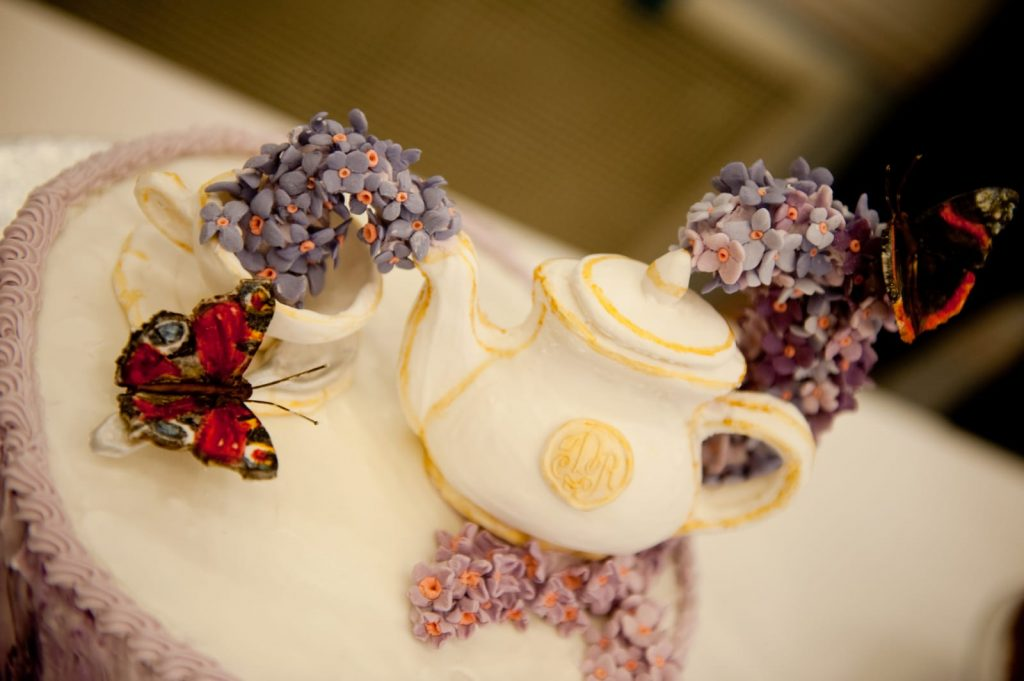 Wedding cake with teapot pouring buddleia and butterflies